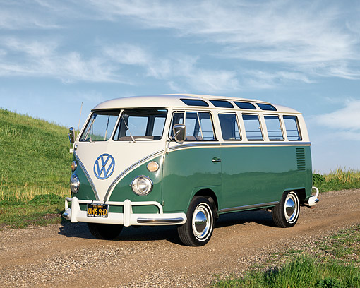 AUT 22 RK1042 02 © Kimball Stock 1966 VW Deluxe Bus Green And White 3/4 Front View On Dirt By Grassy Hill