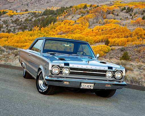 AUT 22 RK1124 04 © Kimball Stock 1967 Plymouth Belvedere GTX Hemi Silver 3/4 Front View On Pavement By Dry Grass Hill