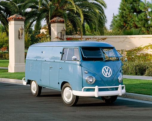 AUT 22 RK1258 02 © Kimball Stock 1960 VW Double Cargo Panel Van Blue 3/4 Front View On Pavement By Wall And Palm Trees