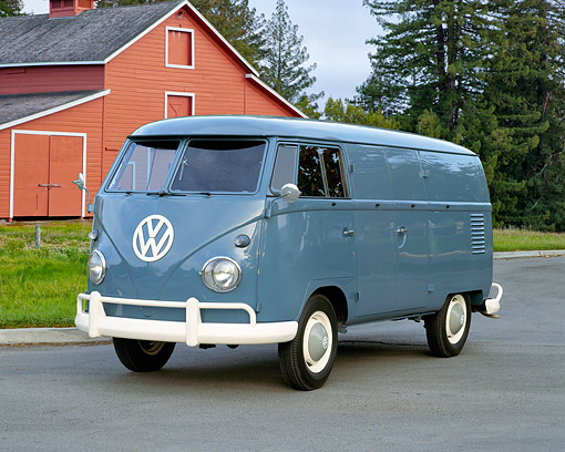 AUT 22 RK1260 02 © Kimball Stock 1960 VW Double Cargo Panel Van Blue 3/4 Front View On Pavement By Barn