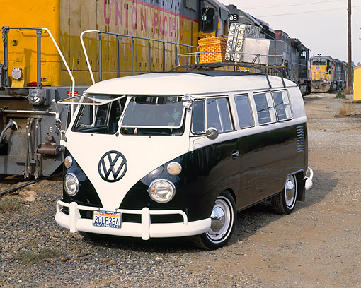AUT 22 RK1265 01 © Kimball Stock 1964 VW Bus Black And White 3/4 Front View On Dirt By Train