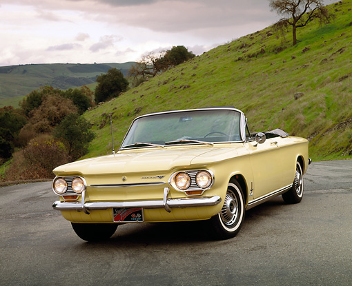 AUT 22 RK1298 03 © Kimball Stock 1963 Chevrolet Corvair Turbo Spyder Yellow 3/4 Front View On Pavement By Grass Hill