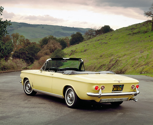 AUT 22 RK1300 06 © Kimball Stock 1963 Chevrolet Corvair Turbo Spyder Yellow 3/4 Rear View On Pavement Trees Grass Hill Red Filter