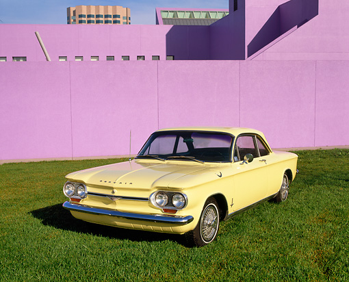 AUT 22 RK1347 08 © Kimball Stock 1964 Chevrolet Corvair Monza Sport Coupe Yellow 3/4 Front View On Grass