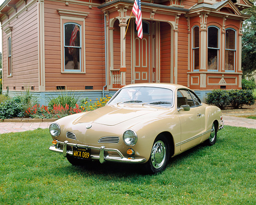 AUT 22 RK1442 01 © Kimball Stock 1968 Volkswagen Karmann Ghia Coupe Beige 3/4 Front View On Grass By House