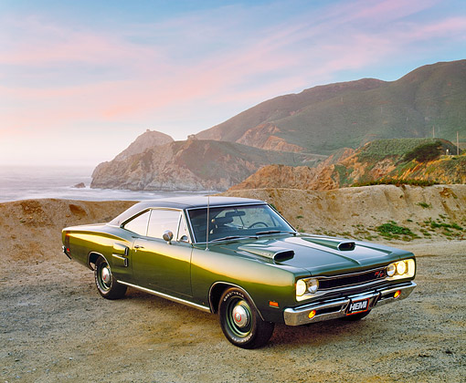 AUT 22 RK1501 02 © Kimball Stock 1969 Dodge Hemi Coronet RT Green 3/4 Front View On Sand By Ocean And Rocks Filtered