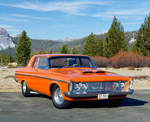 AUT 22 RK1542 03 © Kimball Stock 1963 Plymouth Belvedere 426 Max Wedge Orange 3/4 Front View On Pavement By Trees
