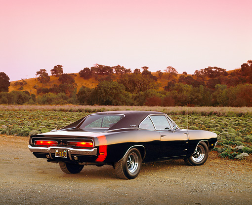 AUT 22 RK1546 07 © Kimball Stock 1969 Dodge Charger RT Black Rear 3/4 View On Dirt