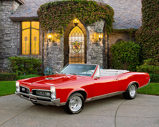 AUT 22 RK1568 04 © Kimball Stock 1967 Pontiac GTO Convertible Red 3/4 Front View On Pavement By House