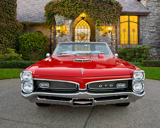 AUT 22 RK1571 03 © Kimball Stock 1967 Pontiac GTO Convertible Red Front View On Pavement By Brick House