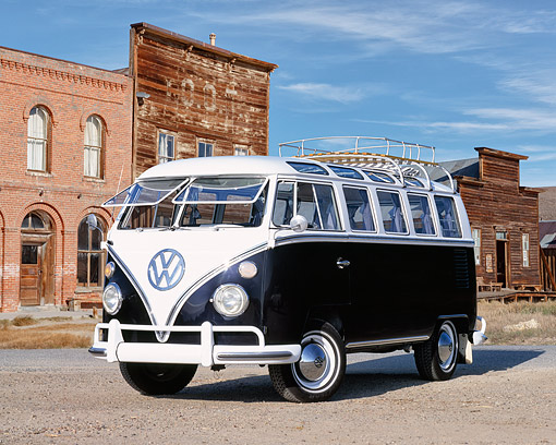 AUT 22 RK1632 02 © Kimball Stock 1965 VW 21 Window Deluxe Microbus Black And White 3/4 Front View On Gravel By Old Buildings