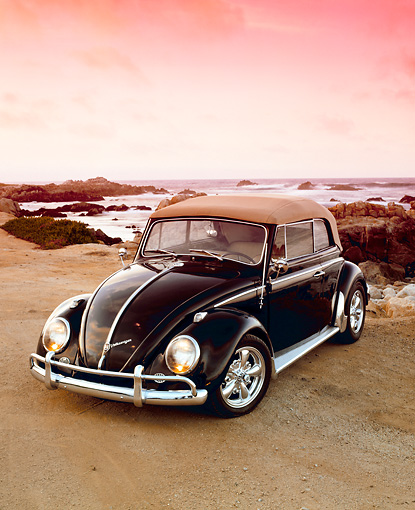 AUT 22 RK1640 04 © Kimball Stock 1963 VW Bug Convertible Black 3/4 Front View On Beach By Ocean And Rocks Filtered