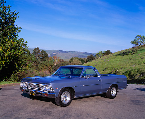 AUT 22 RK1669 01 © Kimball Stock 1966 Chevy El Camino Light Blue 3/4 Side View On Pavement By Grass Hill Blue Sky