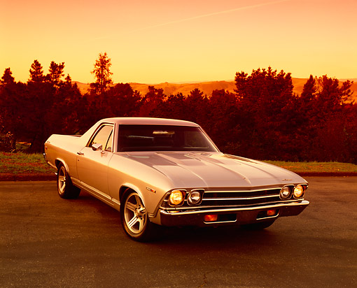 AUT 22 RK1672 03 © Kimball Stock 1969 Chevy El Camino Silver Front 3/4 View On Pavement Trees Background Filtered