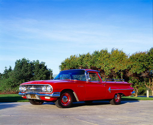 AUT 22 RK1675 02 © Kimball Stock 1960 Chevy El Camino Red Low 3/4 Side View On Pavement Trees Background Blue Sky