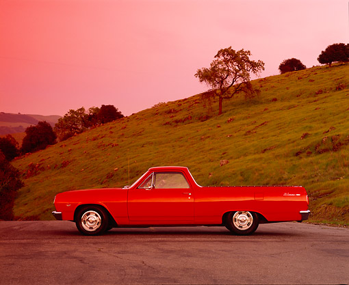 AUT 22 RK1681 03 © Kimball Stock 1965 Chevy El Camino Red Side View On Pavement By Grass Hill Filtered