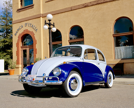 AUT 22 RK1689 02 © Kimball Stock 1967 VW Beetle Two Tone Blue Low 3/4 Front View On Pavement By Building