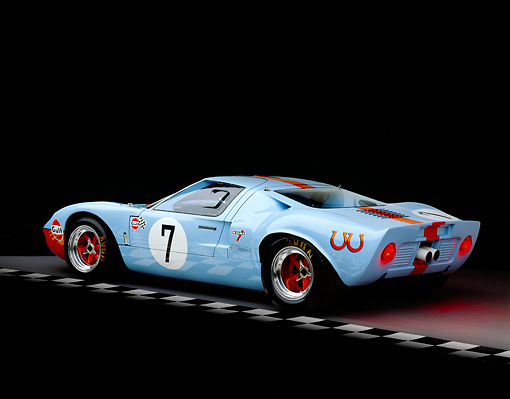 AUT 22 RK1709 07 © Kimball Stock 1968 Ford GT40 Light Blue And Orange FAV Car 3/4 Rear View On Checkered Line Studio
