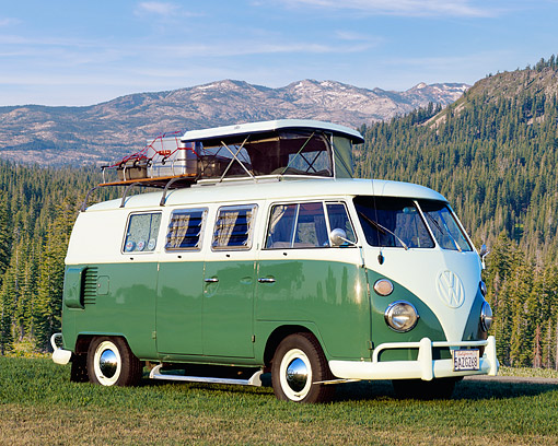 AUT 22 RK1752 02 © Kimball Stock 1965 Volkswagen Westfalia Camper Green And White 3/4 Front View On Grass By Mountains