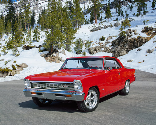 AUT 22 RK1945 04 © Kimball Stock 1966 Chevy Nova Red 3/4 Front View On Pavement By Trees And Snow