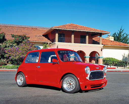 AUT 22 RK2047 02 © Kimball Stock 1969 Austin Mini Cooper Custom Red Low 3/4 Side View On Pavement By Building