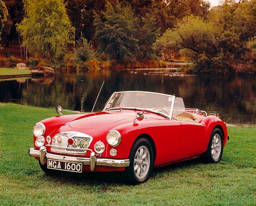 AUT 22 RK2064 02 © Kimball Stock 1961 MGA 1600 Roadster Red Front 3/4 View On Grass By Water