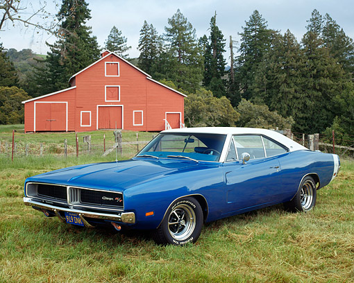 AUT 22 RK2147 03 © Kimball Stock 1969 Dodge Charger R/T SE 440 Blue With White Top 3/4 Front View On Grass By Barn And Trees
