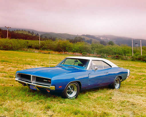 AUT 22 RK2147 04 © Kimball Stock 1969 Dodge Charger R/T SE 440 Blue With White Top 3/4 Front View On Grass By Barn And Trees