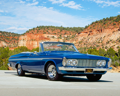 AUT 22 RK2162 05 © Kimball Stock 1963 Plymouth Fury Convertible Blue Low 3/4   Front View On Pavement Blue Sky