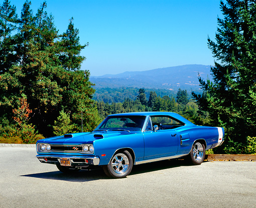 AUT 22 RK2175 03 © Kimball Stock 1969 Dodge Coronet R/T Blue Front 3/4 View On Pavement By Trees