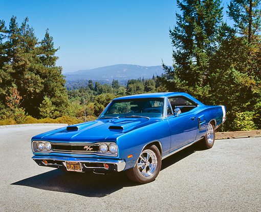 AUT 22 RK2176 03 © Kimball Stock 1969 Dodge Coronet R/T Blue Front 3/4 View On Pavement By Trees