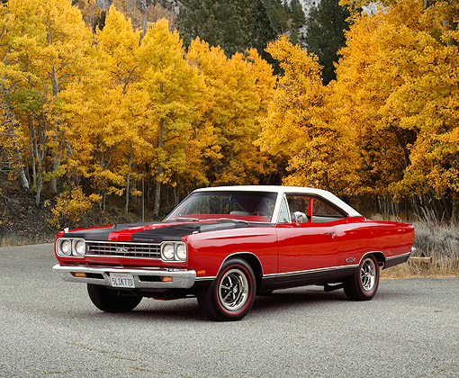 AUT 22 RK2203 02 © Kimball Stock 1969 Plymouth GTX Red And Black 3/4 Front View On Pavement By Trees