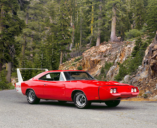 AUT 22 RK2211 01 © Kimball Stock 1969 Dodge Charger Daytona Red 3/4 Side View On Pavement By Trees