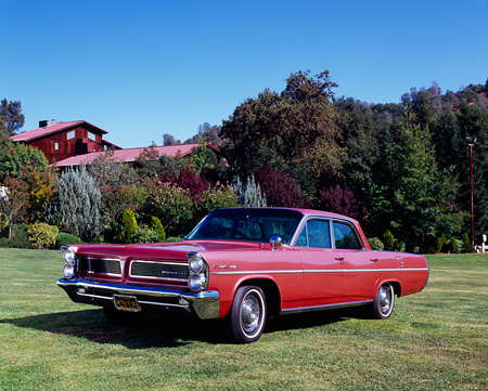 AUT 22 RK2251 01 © Kimball Stock 1963 Pontiac Star Chief Red Front 3/4 View On Grass Trees Background