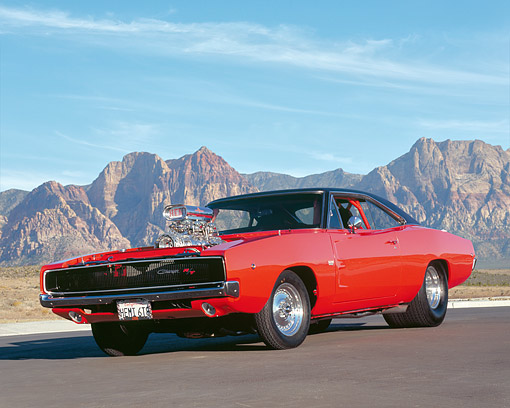 AUT 22 RK2293 05 © Kimball Stock 1968 Dodge Charger R/T 528  Hemi Orange Low 3/4 Front View On Pavement By Dry Hills