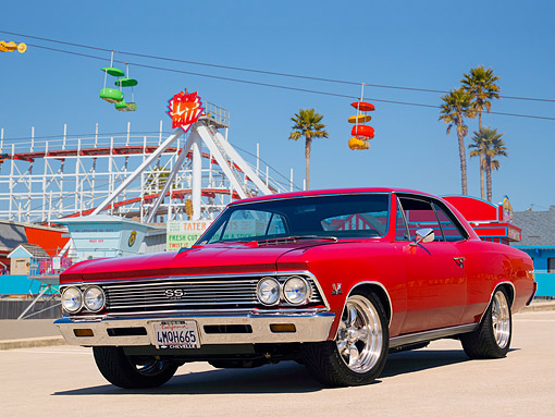 AUT 22 RK2335 01 © Kimball Stock 1966 Chevrolet Chevelle SS 396 Red Low 3/4 Front View On Pavement By Amusement Park