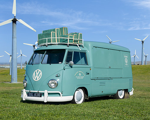 AUT 22 RK2390 01 © Kimball Stock 1962 Volkswagen Vendo Turkis Green 3/4 Front View On Grass By Windmills