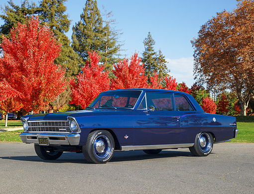 AUT 22 RK2405 01 © Kimball Stock 1967 Chevrolet Nova Chevy II Blue Low 3/4 Side View On Pavement By Trees