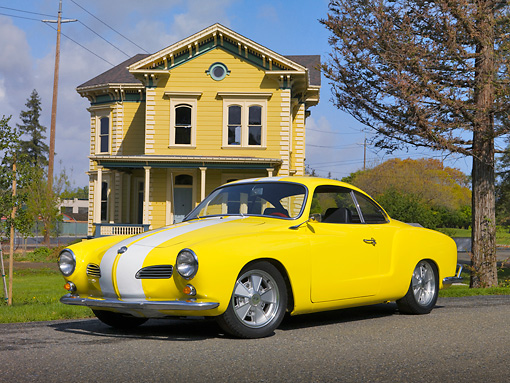 AUT 22 RK2467 01 © Kimball Stock 1961 Volkswagen Karmann Ghia Yellow And White 3/4 Side View On Pavement