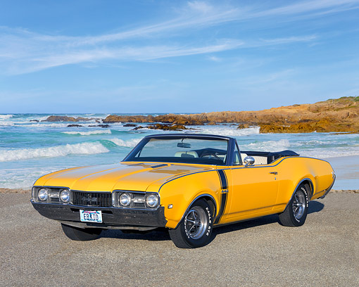 AUT 22 RK2544 01 © Kimball Stock 1968 Oldsmobile 442 Convertible Yellow 3/4 Front View On Pavement