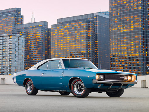 AUT 22 RK2571 01 © Kimball Stock 1968 Dodge Charger RT Blue And White 3/4 Side View On Concrete By Skyscrapers At Dusk