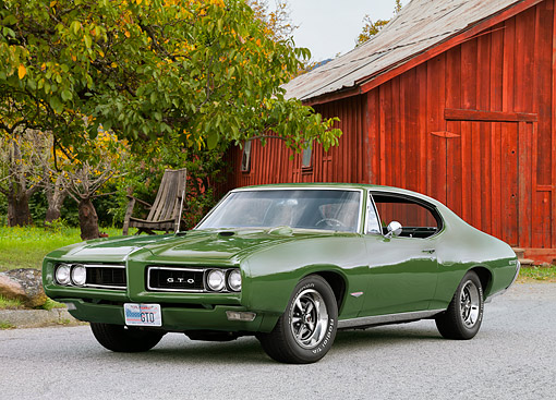 AUT 22 RK2638 01 © Kimball Stock 1968 Pontiac GTO Green 3/4 Front View On Pavement By Barn