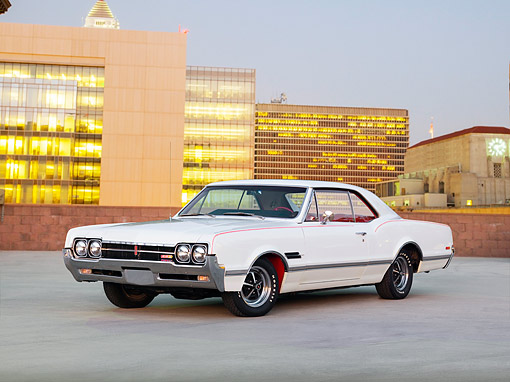 AUT 22 RK2728 01 © Kimball Stock 1966 Oldsmobile 442 White 3/4 Front View On Pavement City