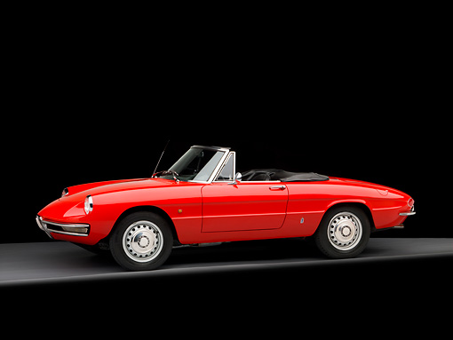 AUT 22 RK2758 01 © Kimball Stock 1966 Alfa Romeo Duetto Spider Red 3/4 Front View Studio