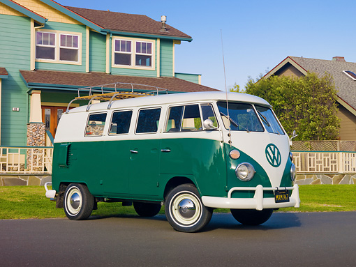 AUT 22 RK2806 01 © Kimball Stock 1964 Volkswagen Kombi Bus Green And White 3/4 Front View On Pavement By House