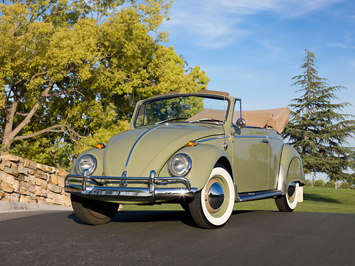 AUT 22 RK2810 01 © Kimball Stock 1965 Volkswagen Beetle Cabriolet Green 3/4 Front View On Pavement By Stone Wall And Trees