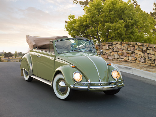 AUT 22 RK2813 01 © Kimball Stock 1965 Volkswagen Beetle Cabriolet Green 3/4 Front View On Pavement By Stone Wall And Trees