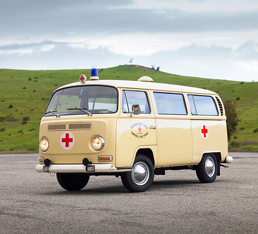AUT 22 RK2817 01 © Kimball Stock 1968 Volkswagen Bus Ambulance Cream 3/4 Front View On Pavement By Hills