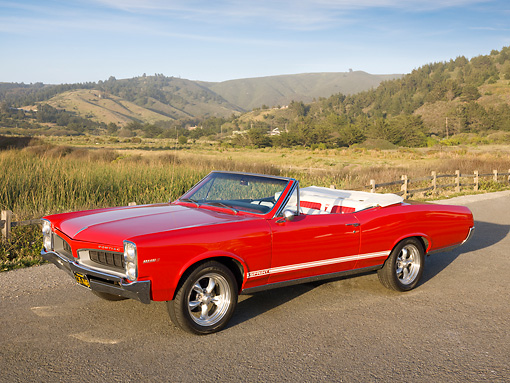 AUT 22 RK2823 01 © Kimball Stock 1967 Pontiac OHC Sprint Convertible Red 3/4 Front View On Pavement By Hills