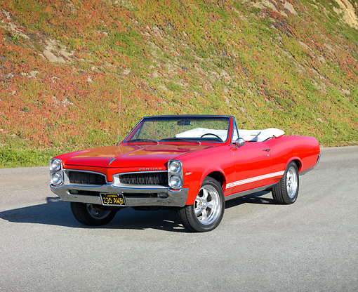AUT 22 RK2825 01 © Kimball Stock 1967 Pontiac OHC Sprint Convertible Red 3/4 Front View On Pavement By Sand Dune